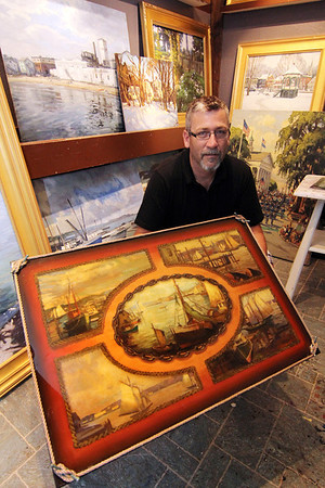 """ALLEGRA BOVERMAN/Cape Ann Magazine. Rockport artist Ken Knowles twith his Parsons table, which is part of the Pathways """"A Place at the Table"""" Gala in November."""
