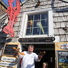 ALLEGRA BOVERMAN/Cape Ann Magazine Kenny Porter of Rockport, left, and Rune DeFort, 7, of Rockport, at Roy Moore's Lobster Shack in Bearskin Neck.