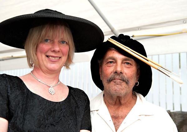 """Gloucester:  Artist John Nesta and his wife Jennifer show off their hats at  """"Pass the Hats"""" - a Gala Celebration of Gloucester's Rocky Neck Cultural District on Friday, August 17, Desi Smith/Gloucester Daily Times. August 17,2012"""