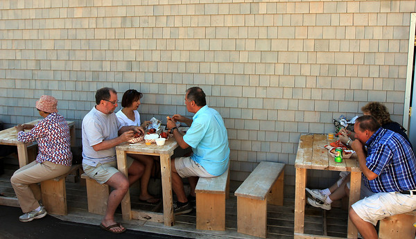 ALLEGRA BOVERMAN/Cape Ann Magazine The outdoor seating area at Roy Moore's Lobster Co. on Bearskin Neck in Rockport.