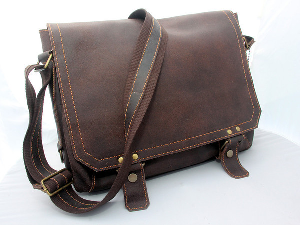 ALLEGRA BOVERMAN/Cape Ann Magazine Conservative? This distressed leather messenger's bag by David King holds a laptop and roomy enough for folders when you absolutely have to bring work home.  Bearskin Neck Leathers, 7 Old Harbor Road Rockport, 978-546-2258, bearskinneckleathers.com. $170
