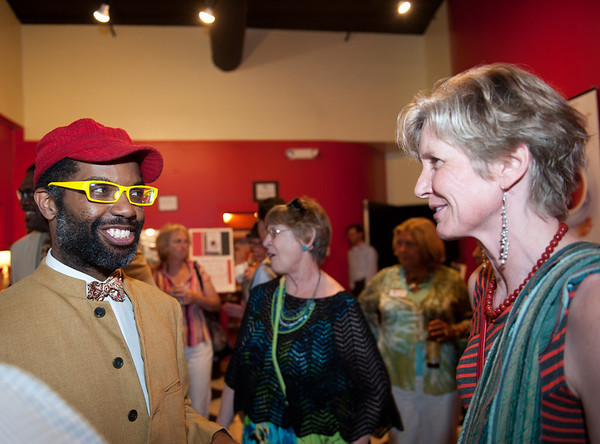 Gloucester: Actor Anthony Wills Jr, talks to a guest at the Gloucester Stage Company party.   Desi Smith/Gloucester Daily Times. August 8,2012