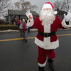 Desi Smith/Cape Ann<br /> Bob Whynott's friend Paul Ichuck, playing Santa, leads the crowd to the trolley. Every year Bob Whynott leads a troop of carolers around Gloucester, visiting elderly housing complexes and nursing homes. The carolers meet at the Whynott house and then take a CATA trolley to the various stops before wrapping up with nibbles and cocoa back at the Whynotts.