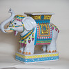 Desi Smith/Cape Ann<br /> Thinking feng shui for your home or office? An elephant with an upraised trunk, showering good luck everywhere, may be the answer. The pachyderm is also a symbol of kindness, majesty and wisdom. White china elephant plant stand or table. $145. White Elephant Shop, 32 Main St., Essex, 978-768-6901, whiteelephantshop.com