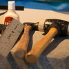 Desi Smith/Cape Ann<br /> Paul Durgin's tools of the leather trade: an anvil, neatsfoot oil, a ruler, a ball-peen hammer and a rubber-headed mallet.