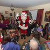 Desi Smith/Cape Ann<br /> Every year Bob Whynott leads a troop of carolers around Gloucester, visiting elderly housing complexes and nursing homes. The carolers meet at the Whynott house and then take a CATA trolley to the various stops before wrapping up with nibbles and cocoa back at the Whynotts. Entertaining the party is Paul Ichuck as Santa.