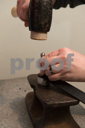 Desi Smith/Cape Ann<br /> Using a miniature anvil and a punch, Paul Durgin of Bearskin Neck Leathers adds a snap to a leather bracelet.
