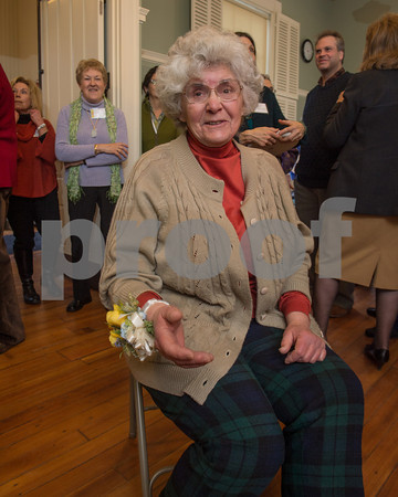 Desi Smith/Gloucester Daily Times<br /> Rockport artist Betty Lou Schlemm, wearing her wrist corsage, takes the seat of honor at a surprise party celebrating her 80th birthday at the Rockport Community House on Jan. 12, 2014.