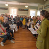 Desi Smith/Cape Ann Betty Lou Schlemm, seated, front, is surprised as one of her former art students from years ago reads a speech about Betty who has painted and taught for many many decades on Cape Ann, at her 80th Birthday Surpise Event at the Rockport Community Center Sunday afternoon. <br /> January 12,2013.
