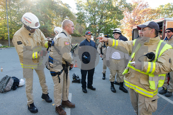 Getting ready to take part in mock turbine rescue in Gloucester are, from left, Peabody firefighters Russ Lewis and Dan Dean, an unamed observer, Lynn firefighter Denis Ring and Andover firefighter Al Del Dotto. The men are all members of the Essex County Technical Rescue Team.