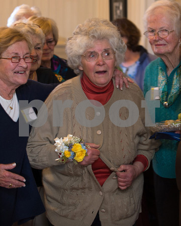 Desi Smith/Cape Ann  Betty Lou Schlemm is taken by surprise as she enters the Rockport Community House  to find a large crowd of people who came to honor her on her 80th birthday.  <br /> January 12,2013.