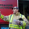 Desi Smith/Cape Ann<br /> Andover firefighter Al Del Dotto shouts out directions to other members of the Essex County Technical Rescue Team. The Reading Fire Department lent its equipment to the team, but because of a scheduling conflict its team members did not participate in the mock drill this day.