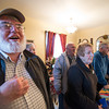 Desi Smith/Cape Ann<br /> Jeff Parsons, left, and others practice singing Christmas carols at the Whynott home. Every year Bob Whynott leads a troop of carolers around Gloucester, visiting elderly housing complexes and nursing homes. The carolers meet at the Whynott house and then take a CATA trolley to the various stops before wrapping up with nibbles and cocoa back at the Whynotts.