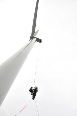 Desi Smith/Cape Ann  Ipswich Fire Lt. Andy Theriault (outside basket) lowers North Andover firefighter John Weir down some 400 feet in a rescue training exercise with the the Essex County Technical Rescue Team at the Varian Semiconductor's wind turbine on Dory Road in Gloucester October 18, 2013.