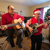 Every year Bob Whynott leads a troop of carolers around Gloucester, visiting elderly housing complexes and nursing homes. The carolers meet at the Whynott house and then take a CATA trolley to the various stops before wrapping up with nibbles and cocoa back at the Whynotts. Getting the party started on their guitars are Greg Verga, left, and Whynott.