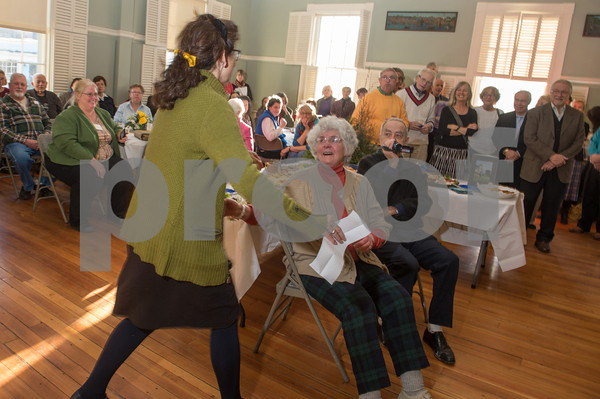 Desi Smith/Cape Ann  Betty Lou Schlemm, seated, is surprised as one of her art students from years ago walks up to deliver a speech about Betty who has painted and taught for many many decades on Cape Ann, at her 80th Birthday Surpise Event at the Rockport Community Center Sunday afternoon. <br /> January 12,2013.