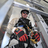 """Desi Smith/Cape Ann<br /> Peabody firefighter Dan Dean attaches himself to the """"lift assist,"""" a motorized pulley which will help up the ladder inside Varian Semiconductor's 497-foot tall wind turbine on Dory Road in Gloucester. Dean, a member of the Essex County Technical Rescue Team, was working with team on mock rescue drill on Oct. 25, 2013."""
