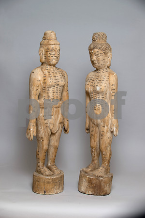 Desi Smith/Cape Ann<br /> Contemplate the serene expressions, and the locations of energy meridians on these Asian acupuncture dolls, gessoed wood, $650 for the pair. Bider's Antiques,67 Main St., Essex, 508-633-4858, bidersantiques.com.