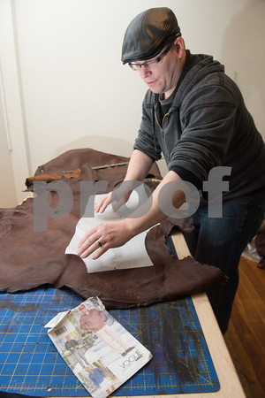 Desi Smith/Cape Ann<br /> Paul Durgin of Bearskin Neck Leathers fits a piece of Vogue for Men pattern for scooter jacket, similar to a motorcycle jacket, on a deerhide tanned and brought in by a New York hunter.