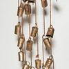 Desi Smith Photo.          Single strand of temple bells ($10 to $14) at Floating Lotus, Bearskin Neck