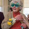 Desi Smith/Cape Ann   Betty Lou Schlemm, who has painted and taught for many many decades on Cape Ann, was given a pair of birthday glasses and a corsage to wear at her 80th birthday surprise event at the Rockport Community House on January 12,2014
