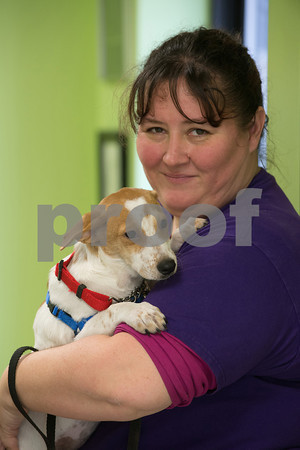Desi Smith Staff photo/Gloucester Daily Times.  Jacquie Harloff of Gloucester and volunteer at the Cape Ann Animal Aid located at Christopher Cutler Animal Shelter on Paws Lane, holds 4 month old Miracle, a Sato rescue dog from Puerto during Holiday Open House on Saturday, Dec. 7.