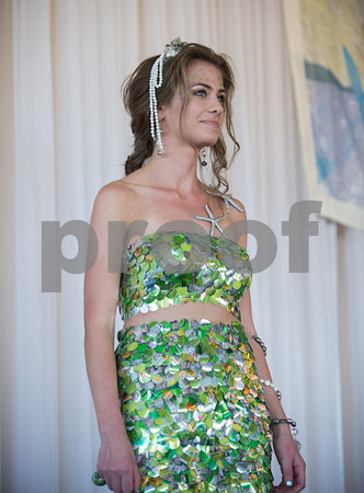 Desi Smith/Cape Ann<br /> Gina Caseldon models a mermaid dress, made of pastilles punched out of green soda cans and designed by her mother, Donna Caseldon of Annisquam.