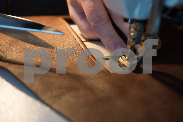Desi Smith/Cape Ann<br /> Paul Durgin of Bearskin Neck Leathers stitches down the edges of a slash pocket in a panel for a custom coat he is making.