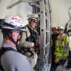 Desi Smith/Cape Ann<br /> Inside the base of the wind turbine are, from left, Ipswich firefighter Gus McInnis, Peabody firefighter Dan Dean, Lawrence firefighter Paul King, Andover firefighter Al Del Dotto, and Ipswich firefighter Lee Prentis. The men, members of the Essex County Technical Rescue Team, were taking part in a rescue drill at Varian Semiconductor's 400-foot wind turbine on Dory Road in Gloucester.