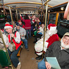 Desi Smith/Cape Ann<br /> Riding the trolley to the first stop are carolers Shirley and Mark French, seated front left, Jeff Parsons, front right, and Paul Ichuck as Santa, among others. Every year Bob Whynott leads a troop of carolers around Gloucester, visiting elderly housing complexes and nursing homes. The carolers meet at the Whynott house and then take a CATA trolley to the various stops before wrapping up with nibbles and cocoa back at the Whynotts.