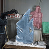 Desi Smith/Cape Ann<br /> Sean Fitzpatrick uses a chainsaw to trim away excess ice while creating a sculpture for Cape Pond Ice. Some his older sculpures, displayed in the Gloucester business's icehouse during tours, are in the background.