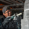 Desi Smith/Cape Ann<br /> Sean Fitzpatrick use an electric jigsaw to create detail on an ice sculpture for Cape Pond Ice in the Gloucester business' icehouse.