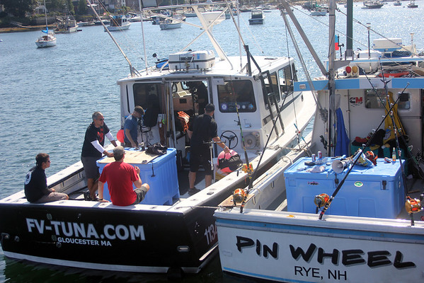 The film and fishing crews sit aboard Season One star the FV-Tuna.com while tied up next to new cast member the Pin Wheel at Gloucester Marine Railways in Rocky Neck. Photo by Allegra Boverman.
