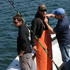"During the filming of promotional stills and video at Gloucester Marine Railways in Rocky Neck for the second season of ""Wicked Tuna"" in mid-September, an Evolve IMG sound technician wires deckhand Sandro Maniaci, left, and Capt. Dave Carraro, center, of the FV-Tuna.com . Photo by Allegra Boverman."
