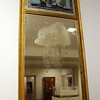 "Photo Courtesy of the Cape Ann Museum. Photo Courtesy of the Cape Ann Museum. This looking glass, or mirror, dates from 1815-1820 and is on display in the Cape Ann Museum galleries. The reverse painting on glass depicts the battle between the Constitution and Guerriere off the coast of Cape Ann, one of the most heralded skirmishes of the War of 1812. After one cannon-ball bounced ""harmlessly"" off the side of the Constitution, a crew member is said to have yelled ""Huzzah! Her sides are made of iron!"" This battle, the first of several U.S. Navy victories in ship-to-ship contests, encouraged Americans and chagrined the British."