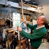 Jim Vaiknoras/Cape Ann Magazine:   Robert Hanlon works in his studio at Walker Creek Gallery in Essex