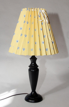 """Clever Covers. These pleated lampshade slipcovers are handmade by Ariana Barron of Rockport, and of La Provence, 4 Main Street, Rockport. They adjust to fit over an existing lampshade of any shape. Two sizes, 12 inches, $26, (shown) and 9 inches, $22, with adjustable width. Also available at  <a href=""""http://www.shopclevercovers.com"""">http://www.shopclevercovers.com</a> Photo by Allegra Boverman."""