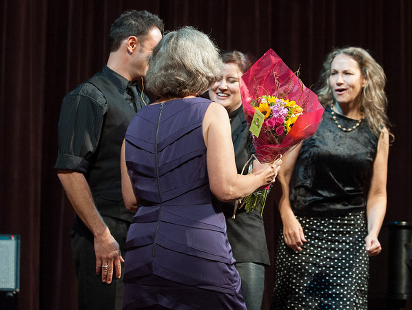 Rockport:  Kay O'Rourke Execitive Director of Wellspring House, hands Grammy Award winners, Paula Cole and Joan Osborne a bouquet of flowers after they played at the Wellspring's House 4th Benefit Concert at the Shalin Liu.  Desi Smith/Gloucester Daily Times. October 4, 2012