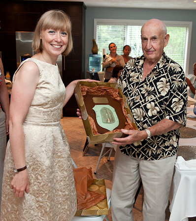 Curtis Dagley receives a plaque from Agata Wolska, who traveled from Krakow Poland, to present it to him. Photo by Desi Smith.