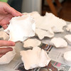 Porcelain works in progress, in the bisque stage, on Anna Kasabian's dining room table, which is set up with stations for each stage of her porcelain production process. Photo by Allegra Boverman.