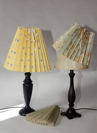 "Clever Covers. These pleated lampshade slipcovers are handmade by Ariana Barron of Rockport, and of La Provence, 4 Main Street, Rockport. They adjust to fit over an existing lampshade of any shape. Two sizes, 12 inches, $26, (left) and 9 inches, $22, (right) with adjustable width. Shade at bottom is folded. Also available at  <a href=""http://www.shopclevercovers.com"">http://www.shopclevercovers.com</a> Photo by Allegra Boverman."