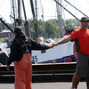 "Bounty Hunter Capt. Bill Monte, left, and a ""Wicked Tuna"" fan greet each other.<br /> Photo by Allegra Boverman."
