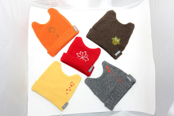 Hatlings child's woolen hats with felt applique. Many colors and styles. Made from upcycled sweaters in Gloucester. Sizes 0 - 8 years old, in three size ranges. $24.95. Available at Zak's in Manchester. Photo by Allegra Boverman.