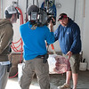 "Rick Schrafft of Compass Seafood on Commercial Street explains what tuna buyers look for in potential purchase to film crew for ""Wicked Tuna."" Photo by Desi Smith."
