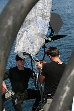 Setting up set up an exterior lighting rig are Josh Edwards, left, and an unnamed crewman from Evolve IMG.<br />  Photo by Allegra Boverman.