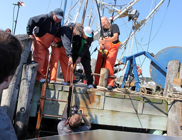 """""""Wicked Tuna"""" captains, from left, Bill Monte of the Bounty Hunter), Dave Carraro of the FV-Tuna.com, Tyler McLaughlin of the Pin Wheel, and Dave Marciano of Hard Merchandise pose for photographer Jesse Edwards of Evolve IMG.<br /> Photo by Allegra Boverman.Photo by Allegra Boverman."""