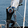 "Josh Edwards of Evolve IMG sets up an exterior lighting rig as the National Geographic Channel films promotional video for the Gloucester-based reality series ""Wicked Tuna.""<br />  Photo by Allegra Boverman."