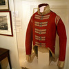 Rob Bibelhauser/Cape Ann Museum. This red coat, on display at the Cape Ann Museum in Gloucester, dates from the war of 1812 and is the only surviving example in the United States of a British enlisted man's uniform from this period. Only six or seven more exist in Europe.An enlisted man in the 104th New Brunswick Regiment of the Army of the British Empire was slated to receive this coat, but it never arrived. It was probably part of a shipment bound for Quebec City on British transport ship which was captured by a Salem privateer. The seized coats were sold to the U.S. Army, which issued them to musician. This coat eventually came into the possession of the Somes family of Gloucester. It was donated to the museum in 1946.