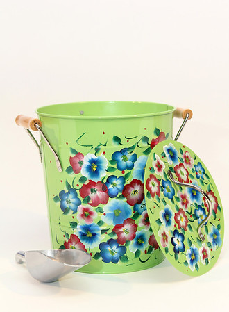 """Handpainted ice bucket with scoop, $30. Handpainted metal ice buckets also available, $20. Pauline's Gift Shop, 512 Essex Ave., Gloucester. 978-281-5558  <a href=""""http://www.paulinesgiftshop.com"""">http://www.paulinesgiftshop.com</a> Photo by Allegra Boverman.Photo by Allegra Boverman."""