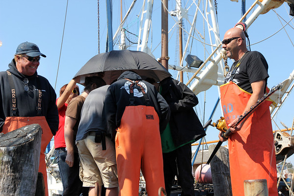 During the filming of promotional stills and video for the second season of Wicked Tuna in mid-September, at Gloucester Marine Railways in Rocky Neck. Checking on how the still images look. Photo by Allegra Boverman.